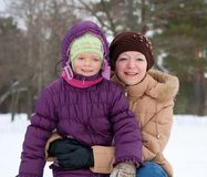 Woman with daughter in winter Stock Photography