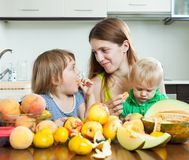 Woman with daughters eating melon Royalty Free Stock Photo