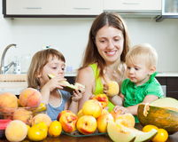 Woman with daughters with melon Royalty Free Stock Images