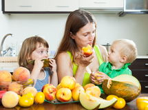 Woman with daughters over table Royalty Free Stock Images
