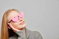 Woman day dreaming with hearts on her eyes Stock Image