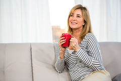 Woman day dreaming Stock Photos