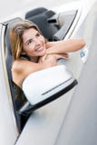 Woman daydreaming in a car Royalty Free Stock Photos