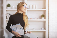 Woman daydreaming in office Stock Photo