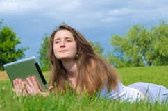 Woman daydreaming in the sunshine Stock Image