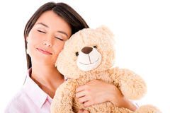Woman daydreaming with a teddy bear Stock Photography