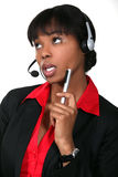 Woman daydreaming at work Stock Images