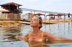 Woman in dead sea royalty free stock photos