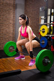 Woman with deadlift royalty free stock photography