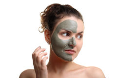 Woman deals on the face mask Royalty Free Stock Image