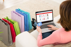 Woman With Debit Card Shopping Online. Young Woman On Sofa Shopping Online With Debit Card Stock Photography