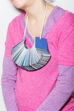 Woman in debt. Image of a woman with bunch of credit cards hanging around her neck Stock Photography