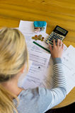 Woman with debts and bills. A woman with unpaid bills has many debts. unemployment and personal bankruptcy Stock Photos