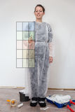 Woman decides for paint colour Stock Photos