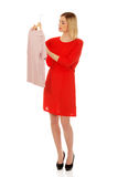 Woman deciding what to buy. Royalty Free Stock Images