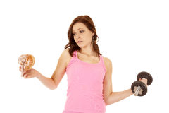 Woman decision doughnut Stock Images
