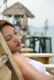 Woman on deck chair. Beautiful girl resting on deck chair Stock Image