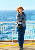Woman on the deck of the ship Stock Photo
