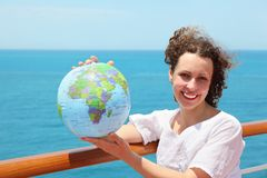 Woman on deck of ship among sea with globe Stock Photography