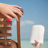 Woman in deckchair Reading Stock Photo