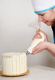 Woman decorate a cake Royalty Free Stock Images