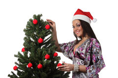 Woman decorate a christmas tree Stock Images