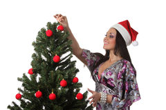 Woman decorate a christmas tree Royalty Free Stock Image