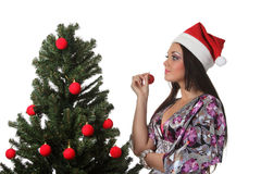 Woman decorate a christmas tree Royalty Free Stock Photography