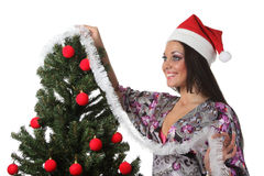 Woman decorate a christmas tree Stock Image
