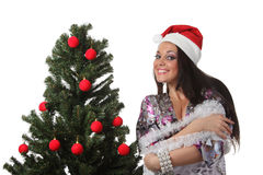 Woman decorate a christmas tree Stock Photography