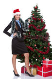 Woman decorate a christmas tree Royalty Free Stock Images