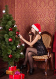 Woman decorate the Christmas tree Royalty Free Stock Photos