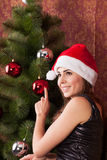 Woman decorate the Christmas tree Royalty Free Stock Photo