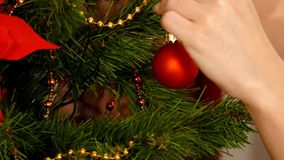 Woman decorate Christmas tree at home stock video