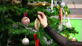 Woman decorate christmas tree stock video footage