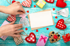 Woman decorate shop window for Valentine's Day. Mock up for text Stock Photos