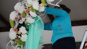 Woman decorate wedding arch with the green fabric stock footage