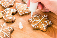 Woman decorated homemade christmas cookie. Closeup Royalty Free Stock Photos