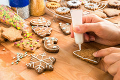 Woman decorated homemade christmas cookie. Stock Photo