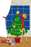 Woman decorates a Christmas Tree Royalty Free Stock Photography