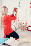 Woman decorates the house, tinted Stock Photos