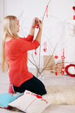 Woman decorates the house Royalty Free Stock Photos