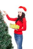 Woman decorating artifical fur tree Royalty Free Stock Photos