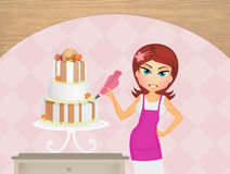 Woman decorating cake Stock Photos