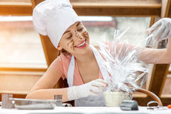 Woman decorating chocolates Stock Image