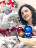 Woman decorating Christmas tree Royalty Free Stock Images