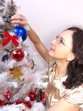 Woman decorating Christmas tree Royalty Free Stock Photos