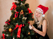 Woman decorating the christmas tree Royalty Free Stock Photos