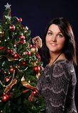 Woman are decorating the Christmas tree Royalty Free Stock Image