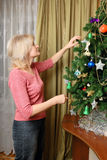 Woman decorating christmas tree Royalty Free Stock Image